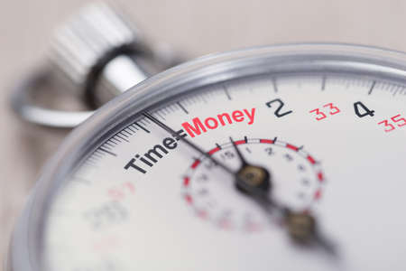 time money: Closeup of stopwatch showing Time equals Money sign Stock Photo