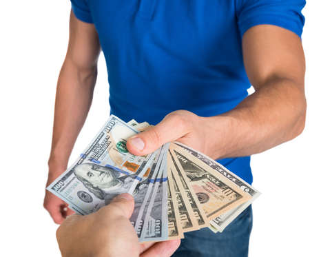 Cropped image of men lending US paper currency isolated over white background photo