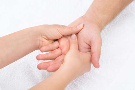 nephropathy: Close-up Of A Physiotherapist Massaging Palm Of A Man