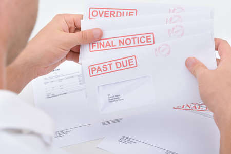 due: Close-up Of A Man Holding Pending Due Statements Stock Photo