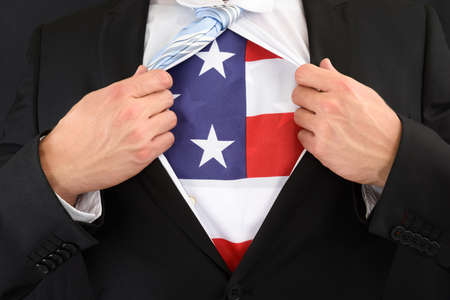 national hero: Close-up Of A Businessman Pulling His Shirt Showing American Flag Stock Photo