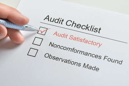 satisfactory: Person Hand Make Tick On Audit Satisfactory In Audit Checklist Paper Stock Photo