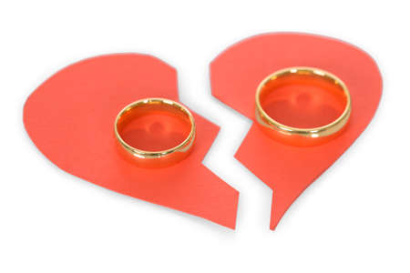 breakup: Golden Ring On Red Broken Heart Over White Background