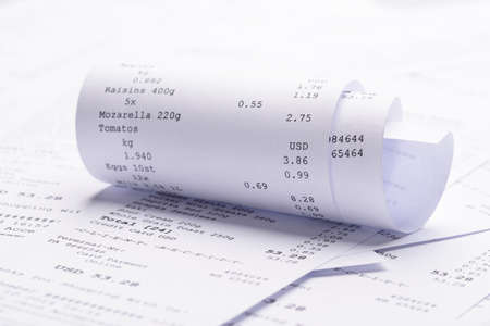 INVOICE: Pile Of Generic Rolled Up Receipt With Costs