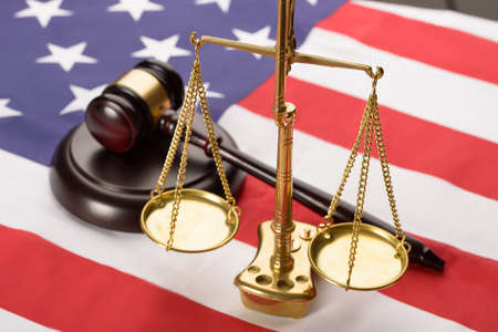 legal court: Justice Scale And Wooden Brown Gavel On Usa Flag