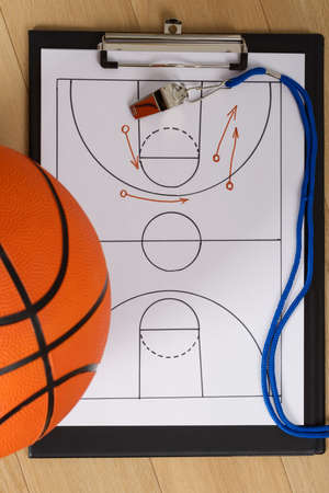 whistles: Close-up Of Basketball With Whistle And Sport Tactics On Paper
