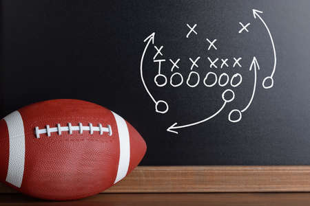 football pitch: Football Play Strategy Drawn Out On A Chalk Board With Rugby Ball Stock Photo
