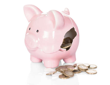 damaged: Broken Piggy Bank With Money Over White Background Stock Photo
