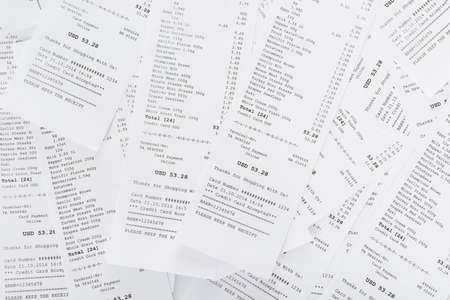 cash slips: Pile Of Generic Shopping Receipts With Costs Stock Photo
