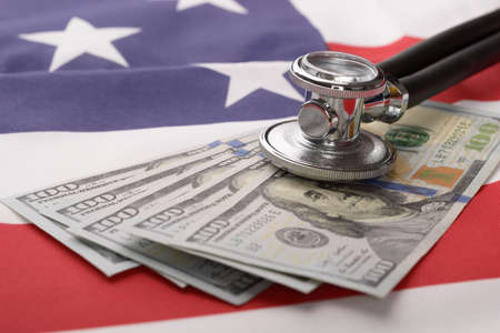 bank of america: Close-up Of Stethoscope On Us Currency And American Flag