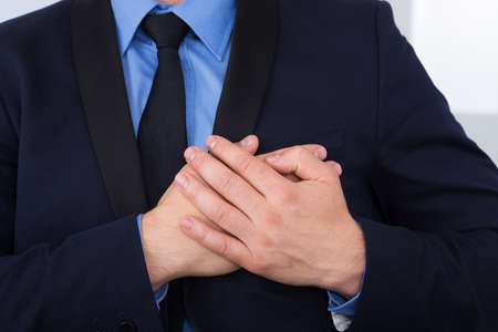 heart pain: Close-up Of A Businessman Suffering From Heart Pain Stock Photo