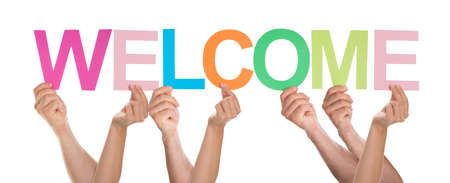 welcome symbol: Group Of People Holding The Word Welcome Over White Background