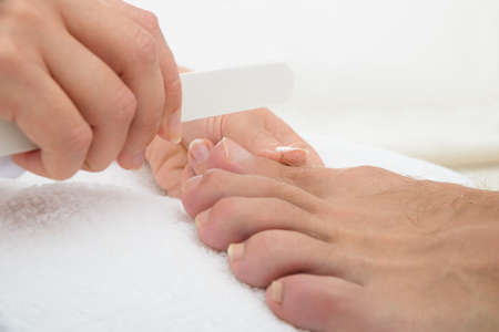 Close-up Photo Of A Manicurist Doing Pedicure