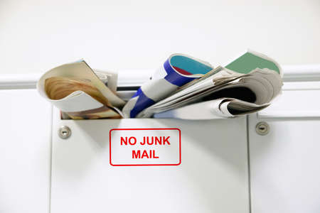 Close-up Of Mailbox Overloaded With Junk Mail