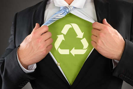 rips: Close-up Of A Businessman Showing Recycled Symbol Under His Shirt