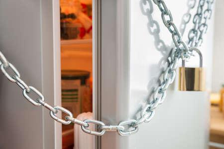 locked: Opened Door Of Fridge Locked With Chain And Padlock
