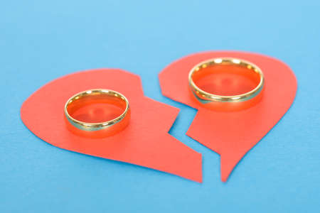 Ring With Broken Heart Over Blue Background
