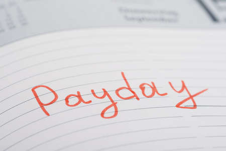 payday: Photo Of Payday Word Written On Diary Book