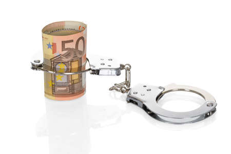 drug bust: Close-up Of Euro Notes With Handcuffs On White Background