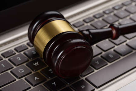 divorce court: Close Up Of Wooden Brown Gavel On Laptop