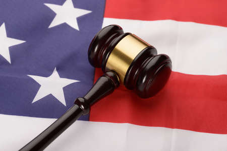 supreme court: Close-up Of Wooden Brown Gavel Over Usa Flag