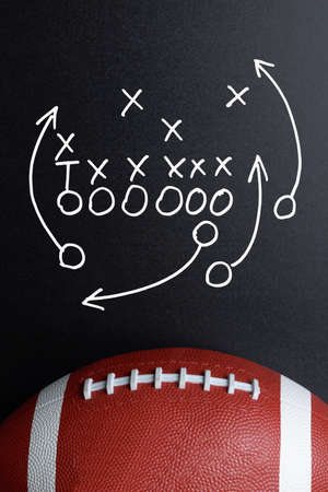 rugby team: Football Play Strategy Drawn Out On A Chalk Board With Rugby Ball Stock Photo