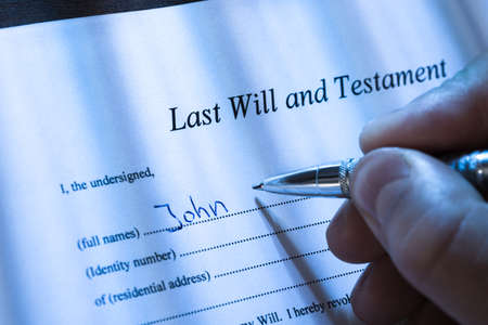 inheritance: Close-up Of A Person Writing Last Will and Testament