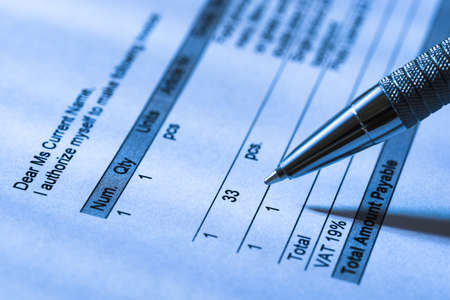 bank records: Close-up Of A Person Filling Invoice Paper With Pen Stock Photo