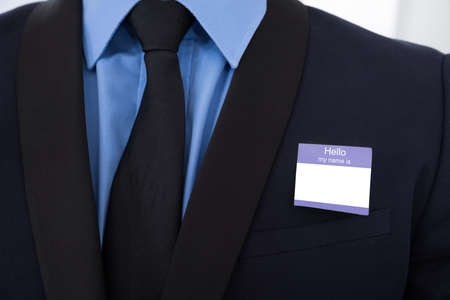 Close-up Of A Businessman In Suit With Blank Identity Card photo
