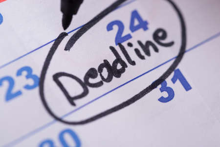 Close-up Of Deadline Written On Date With Black Marker photo