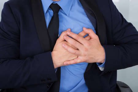 lung disease: Close-up Of A Businessman Suffering From Heart Pain Stock Photo
