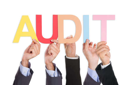 control fraud: Group Of Businesspeople Hands Holding Text Audit Over White Background