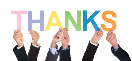acknowledgment: Group Of Hands Holding The Word Thanks Isolated Over White Background Stock Photo