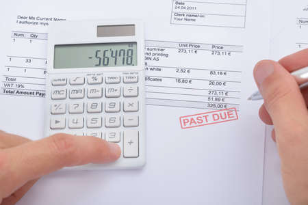 final: Close-up Of Man Analyzing Past Due Statement Using Calculator