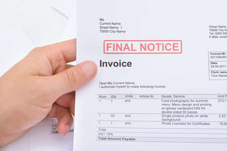 INVOICE: Close-up Of A Man Holding Invoice With Final Notice Stamp On It