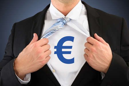rips: Close-up Of Businessman Showing Euro Sign On His Chest Stock Photo