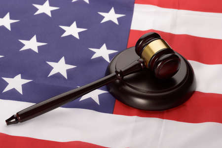 Close-up Of Wooden Brown Gavel Over Usa Flag photo