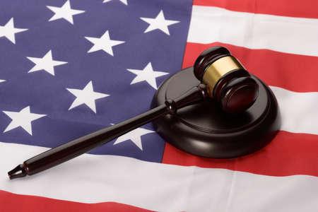 international criminal court: Close-up Of Wooden Brown Gavel Over Usa Flag