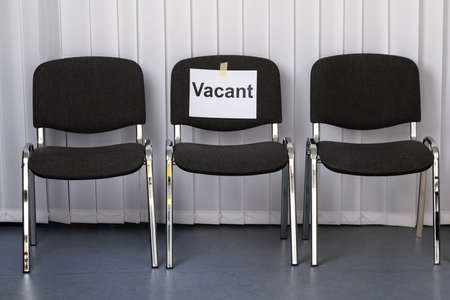 vacant: Office Chair With A Vacant Sign At Work Place Stock Photo