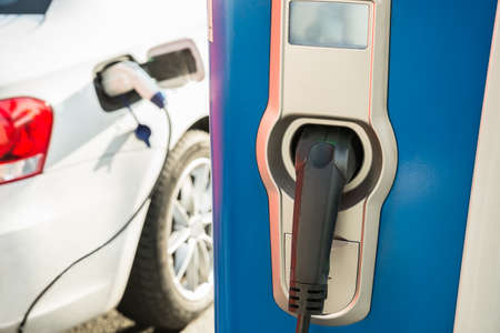 electric power station: Electric Car Is Being Recharged At A Power Station