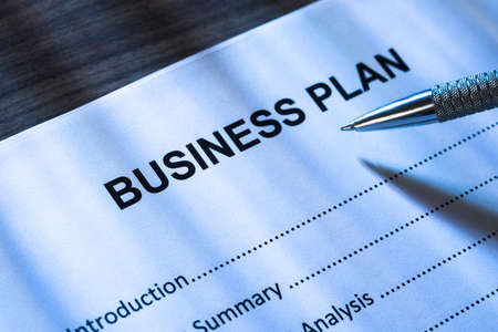 Close-up Of Pen On Business Plan Form photo