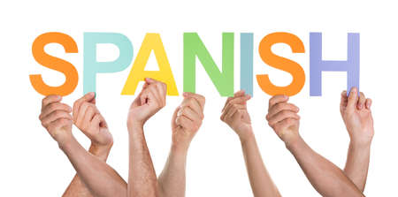 spanish language: Many Persons Holding The Colorful Word Spanish Over White Background