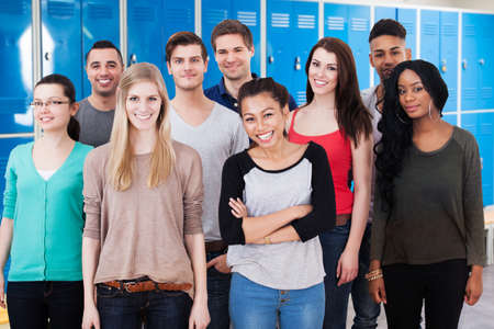 changing room: Group Of Happy Multiethnic College Students Standing Together In Changing Room