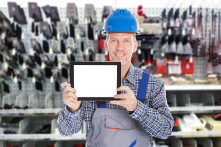 worker construction: Portrait Of Mature Male Worker Holding Digital Tablet Stock Photo