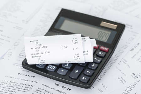 cash receipt: Photo Of Calculator On Generic Receipts With Costs
