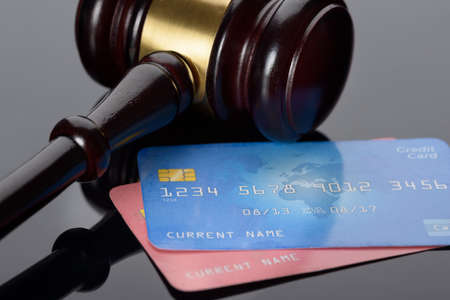 card payment: Close-up Of Wooden Brown Gavel With Credit Cards Stock Photo
