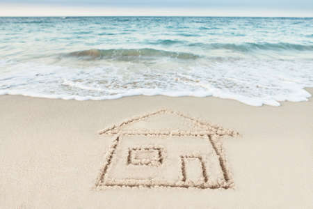 nobody real: House drawn on sand by sea at beach