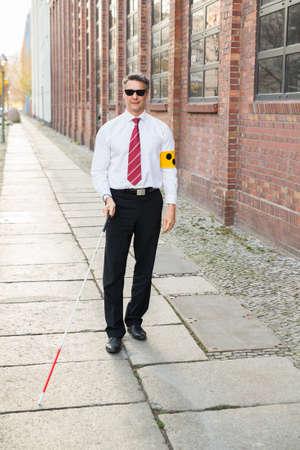armband: Blind Man Walking On Marciapiede Tenere Stick Armband Wearing