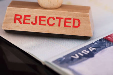 denied: Close-up Photo Of Rejected Stamp On Visa Stock Photo