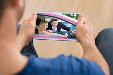 Close-up Of A Man Watching Video On Cellphone photo